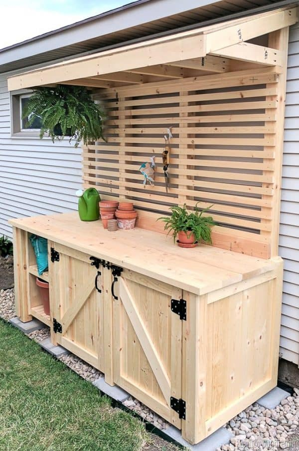DIY potting bench with hidden garbage cans