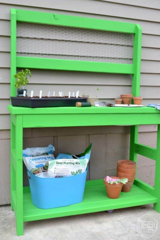 DIY potting bench with chicken wire back