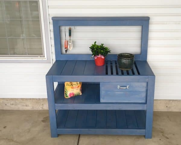 blue DIY potting bench with slatted top