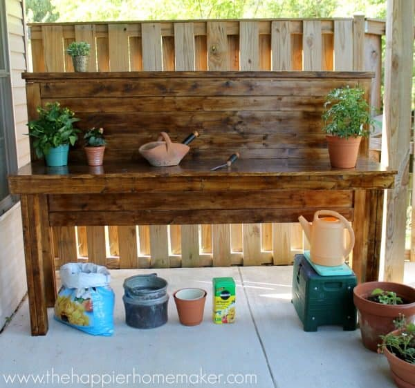 DIY potting bench made from a headboard