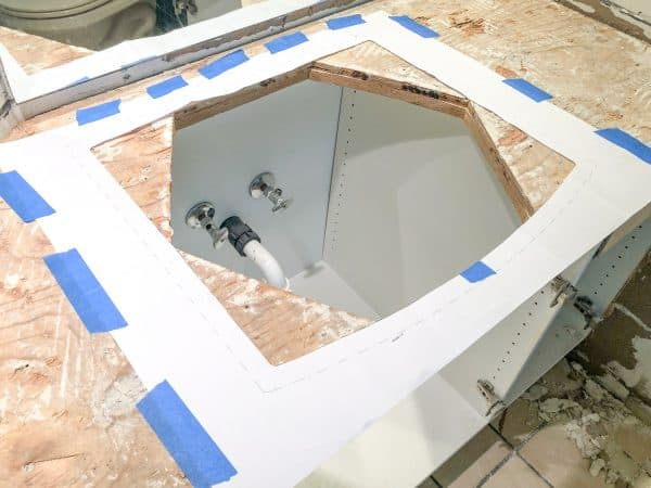 hexagon shaped sink hole with rectangular template for new sink over it