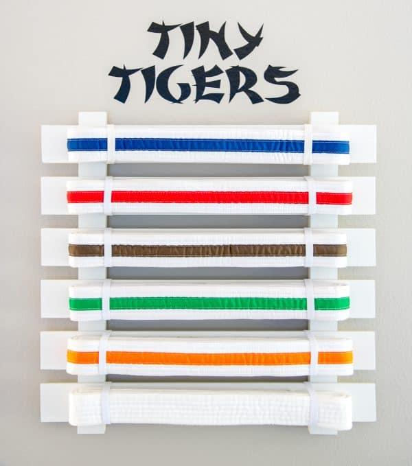 "DIY martial arts belt display with ""Tiny Tigers"" vinyl decal"