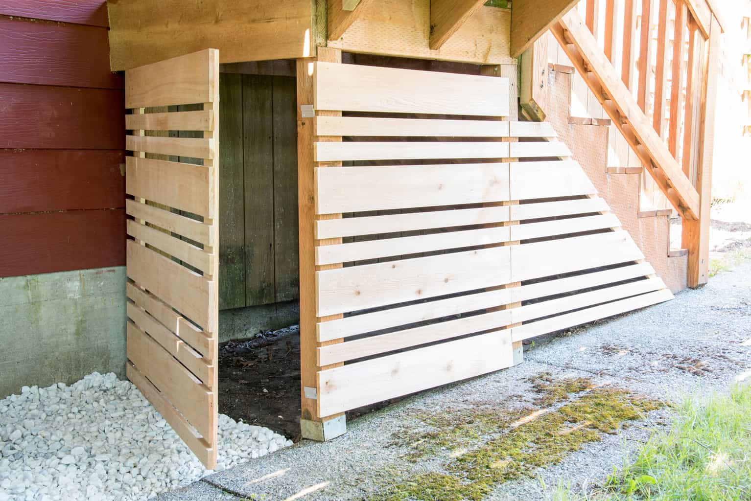 under deck storage area with removable fence panel open