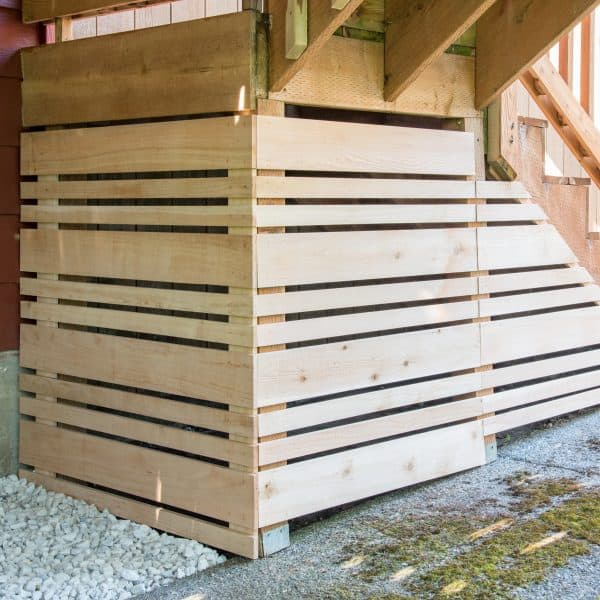 fenced in area under deck stairs for storage with removable fence panel for easy access