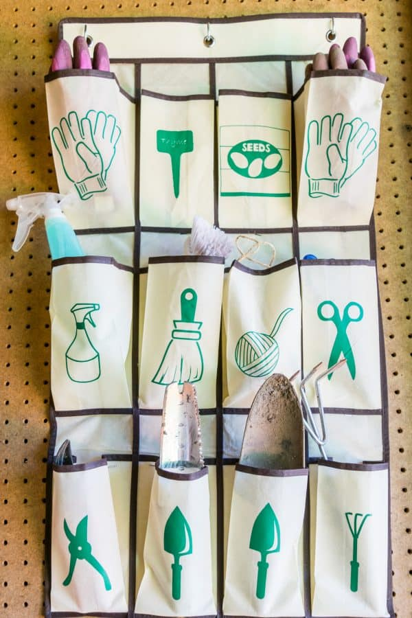 hanging garden tool organizer with graphic labels