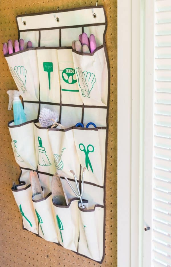 hanging garden tool organizer in shed on pegboard wall