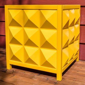 yellow modern outdoor planter box made of diamond shaped PVC panels