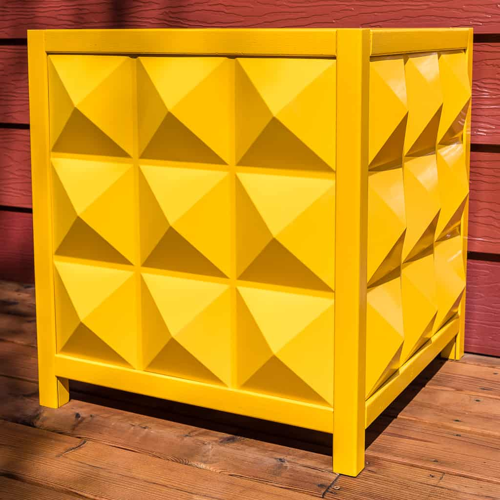 yellow modern outdoor planter box made of diamond shaped PVC panels