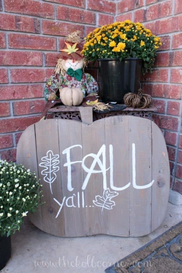 wooden pumpkin sign on front porch
