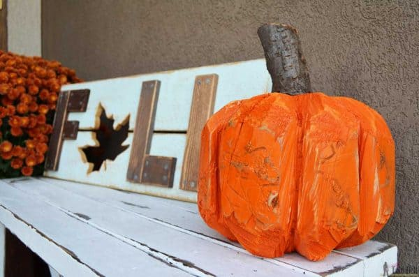 wooden pumpkin carved from a stump