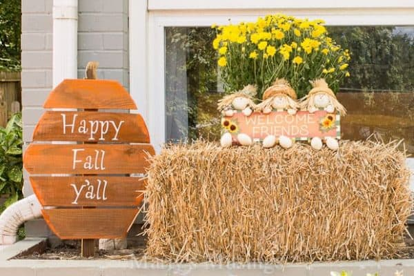 wooden pumpkin sign with hay bale