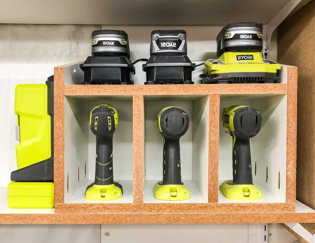 DIY cordless drill storage rack with charger shelf and bit storage