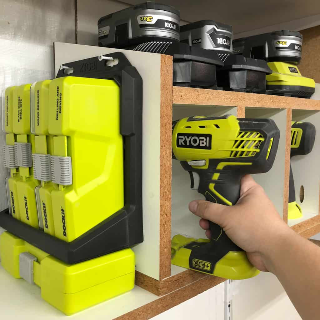 taking drill out of cordless drill storage rack