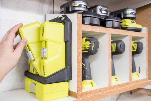 cordless drill storage rack with attached Ryobi Dock-it shelf for drill bits