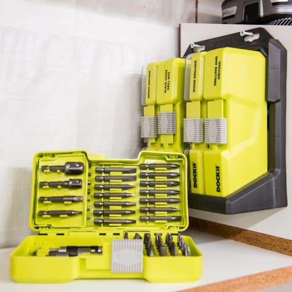 Ryobi dock-it shelf mounted on cordless drill storage rack with one case open