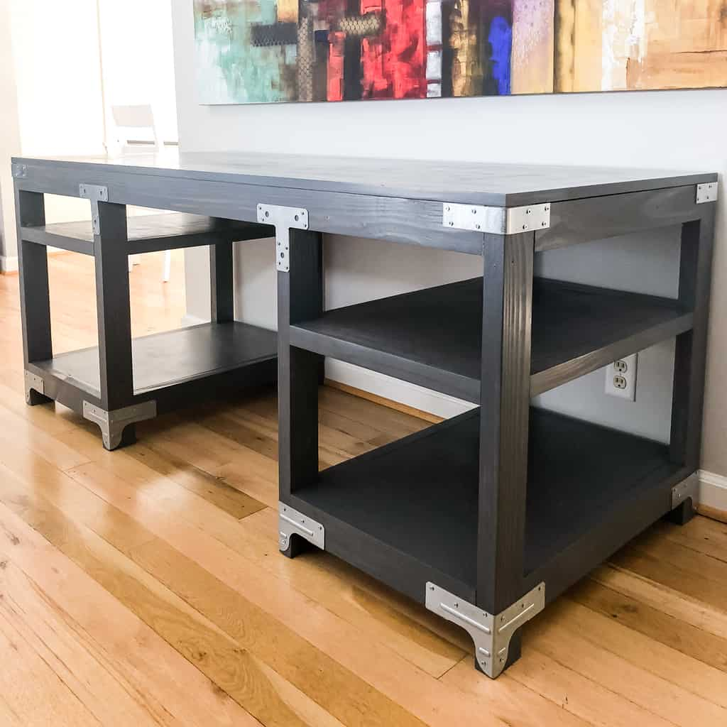 gray stained desk with metal accents