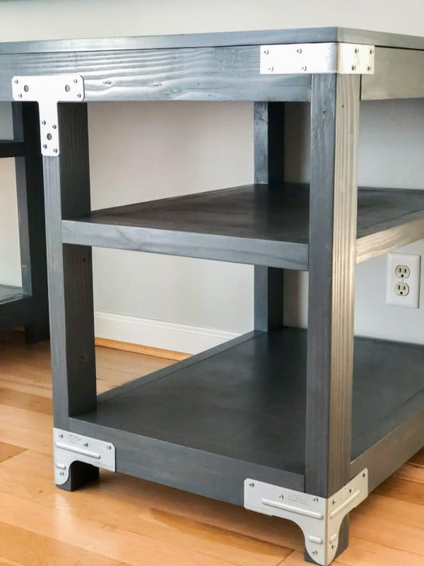 dark gray stained desk with metal hardware on shelves