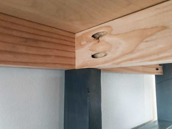 underside of desk showing where the frames connect