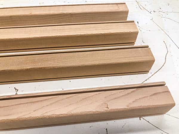 cedar 2x2 boards with grooves cut along length