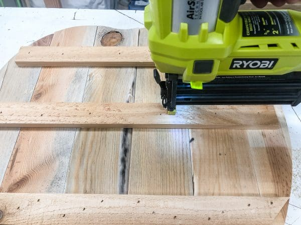 attaching pallet pumpkin pieces together with Ryobi brad nailer