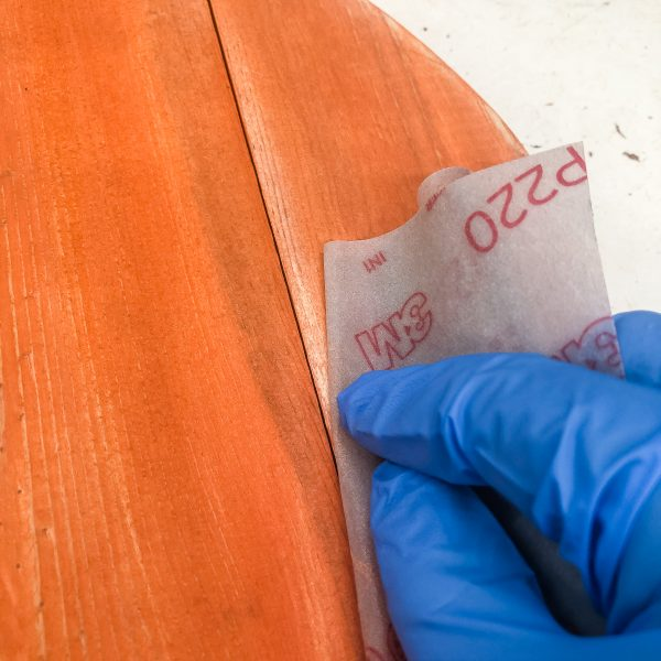 sandpaper sanding edges of pallet pumpkin
