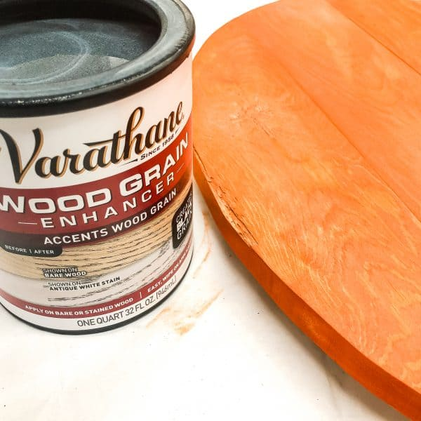 Varathane wood grain enhancer can next to pallet pumpkin
