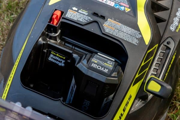 Ryobi self propelled electric lawn mower battery compartment