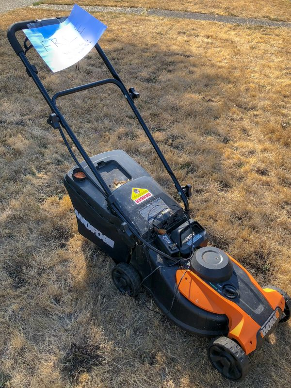 Worx electric lawn mower with free sign