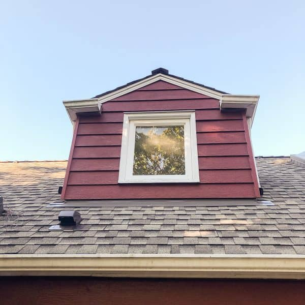 small dormer on the back of a Cape Cod style home