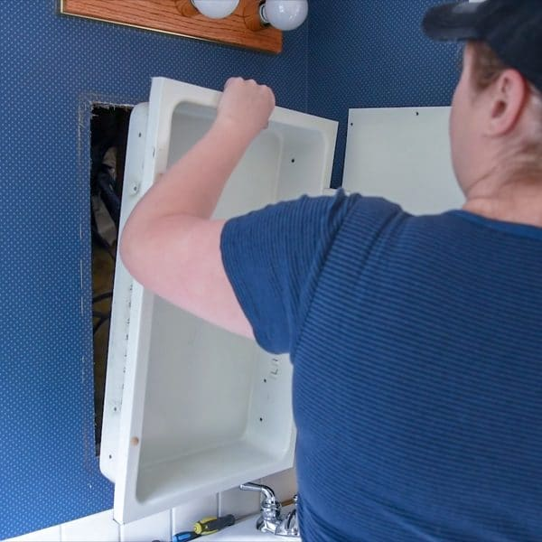 removing a medicine cabinet from the wall