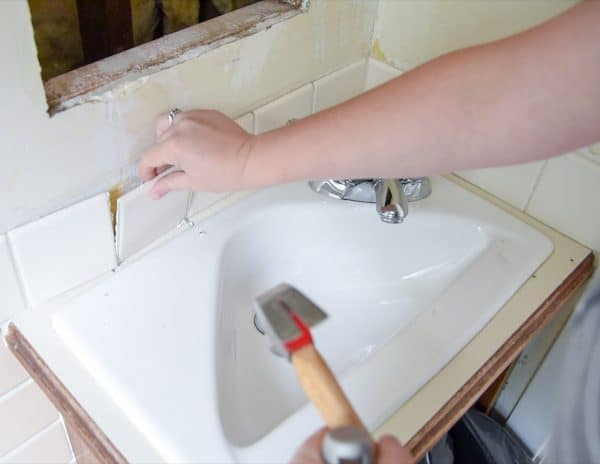 removing tiles from around a vanity sink