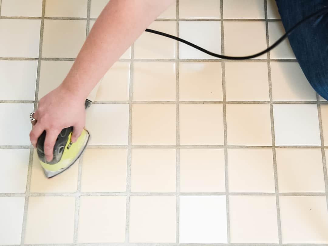 sanding the tile floor before painting