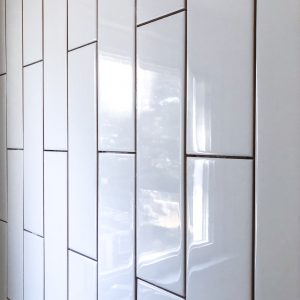 white vertical subway tile pattern