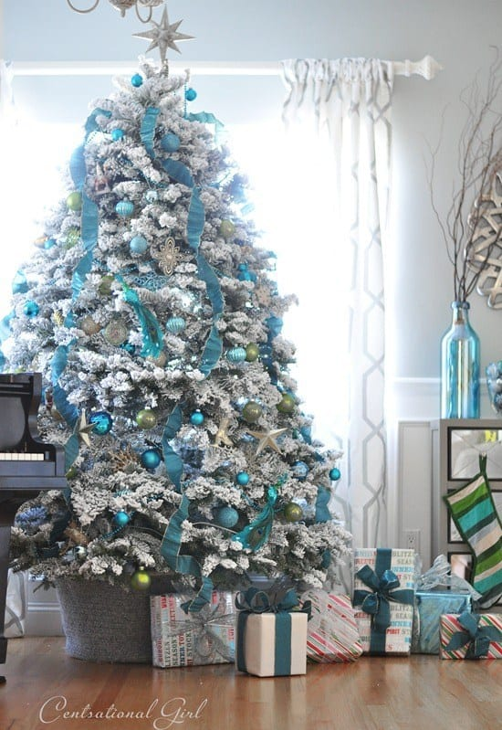 white Christmas tree with blue Christmas decorations