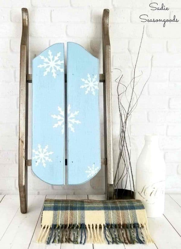 blue decorative sled with snowflake design