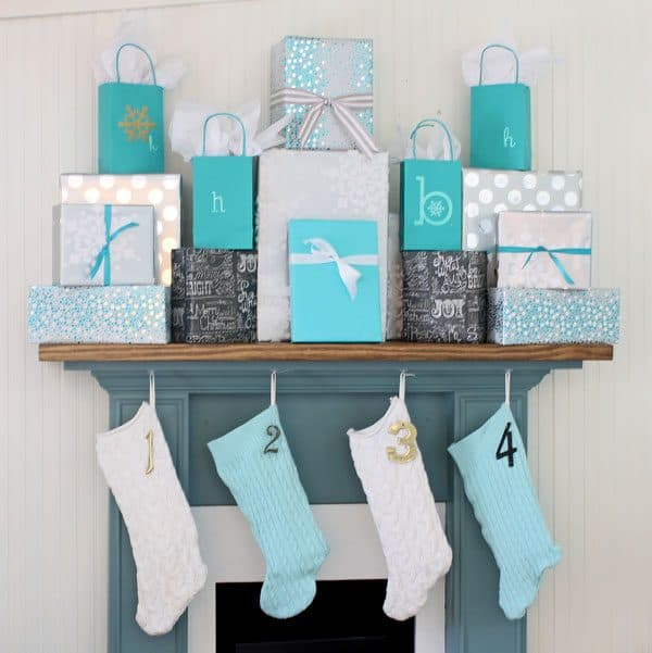 blue Christmas stockings and presents on mantel