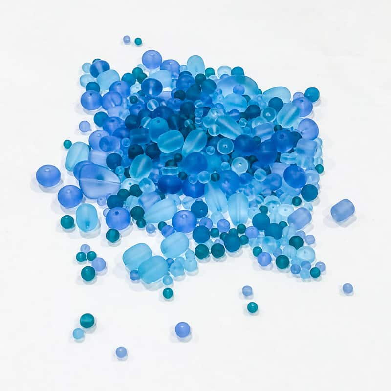 pile of beach glass beads in various shades of blue