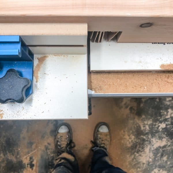 cutting half lap joints on the table saw with lots of sawdust covering feet