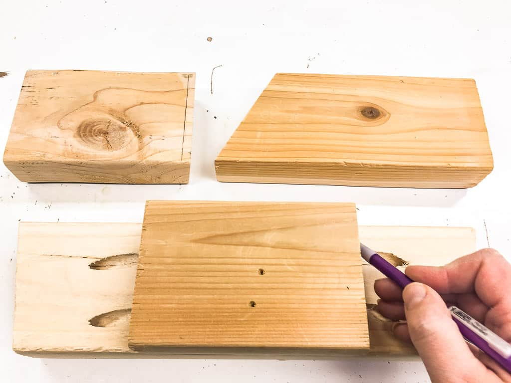 measuring scrap wood pieces for stocking hooks