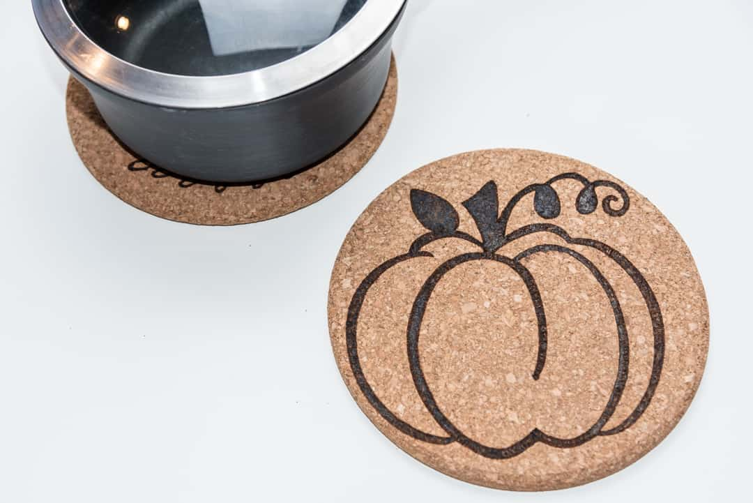 cork trivets with wood burning designs