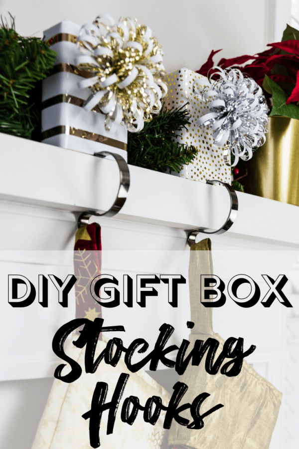 "two stocking hooks with gift wrapped blocks with text overlay ""DIY Gift Box Stocking Hooks"""