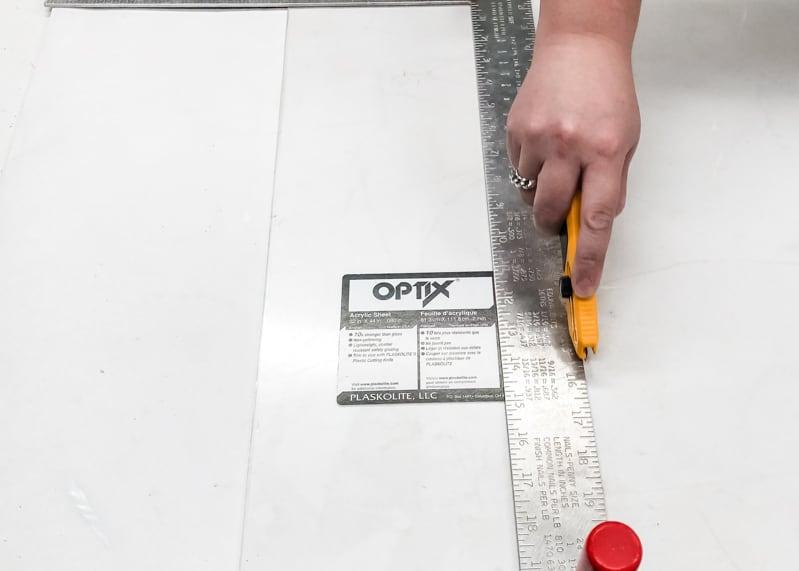 cutting plexiglass with plexiglass knife and straight edge