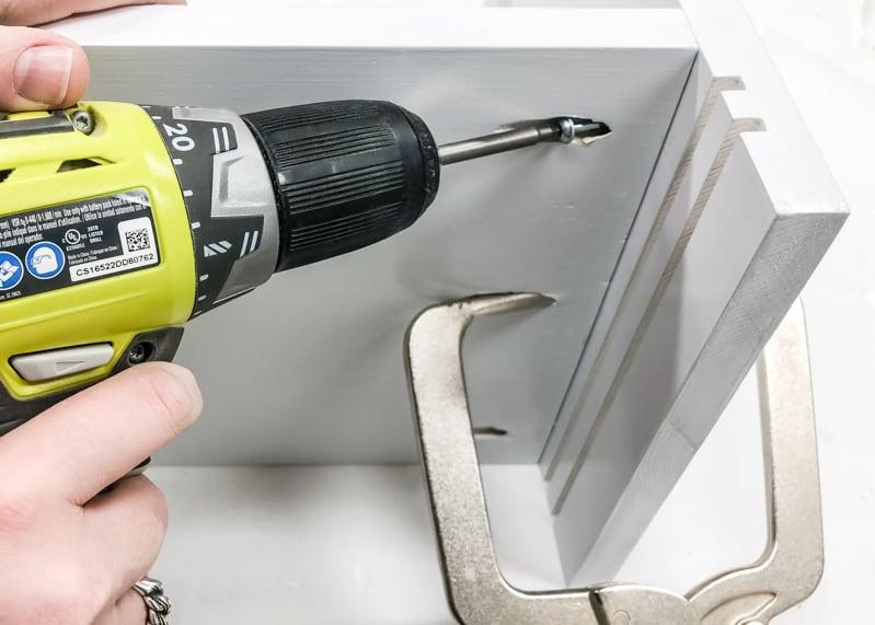 screwing pocket hole screw into side of DIY Lego bin