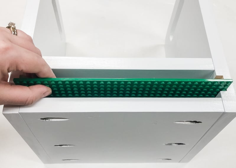 testing fit of Lego baseplates in Lego bin
