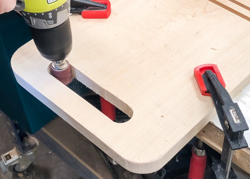 Using a drum sander to sand inside of handle of DIY Lego bin