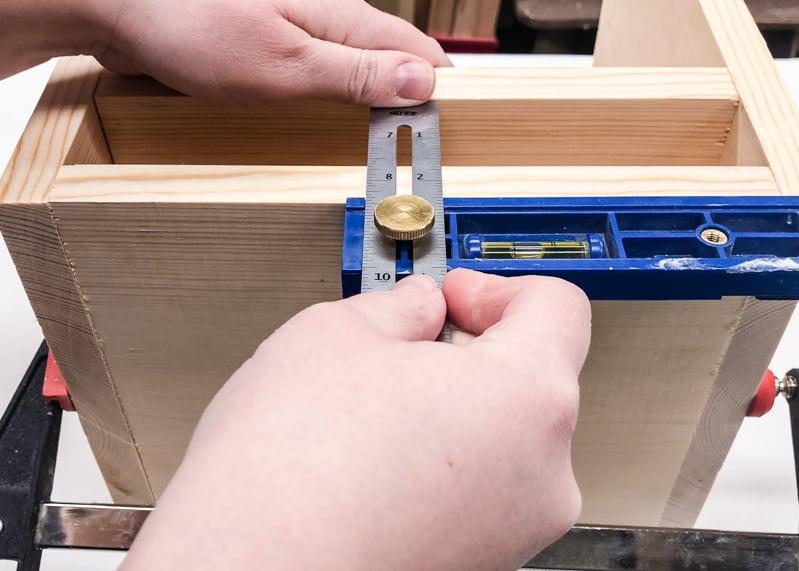 measure shelf placement of lego bin
