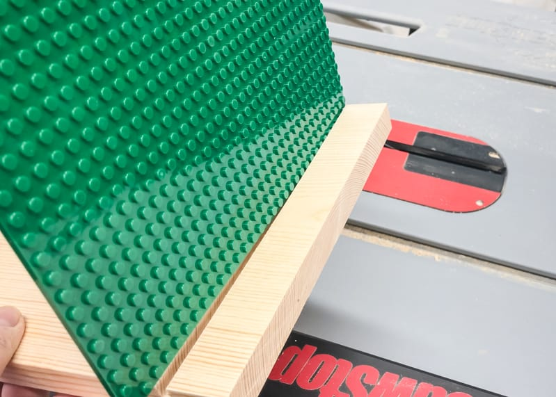 testing fit of lego baseplate slots in sides of lego bin