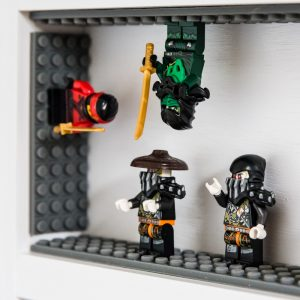 lego minifigure display shelf with minifigures on sides and upside down