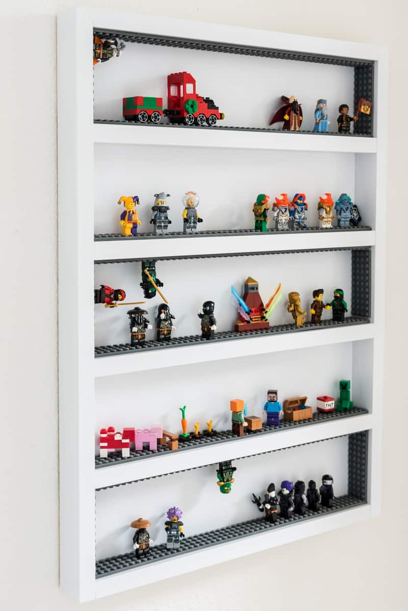six shelf Lego minifigure display case with adhesive Lego strips