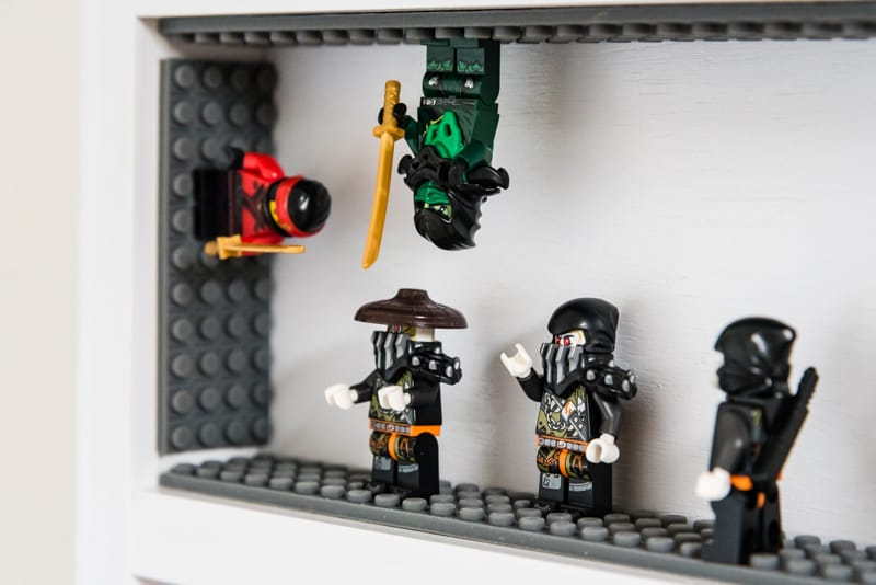 Lego Ninjago minifigures battling in DIY minifig display case